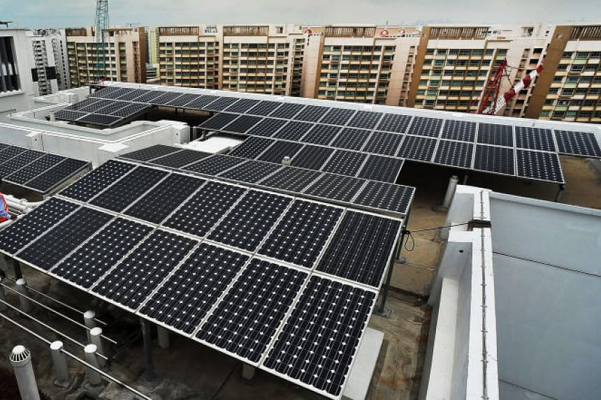 Solar panels on a HDB block roof. The deal will help Facebook reach its goal of supporting its operations in the region with 100 per cent renewable energy.