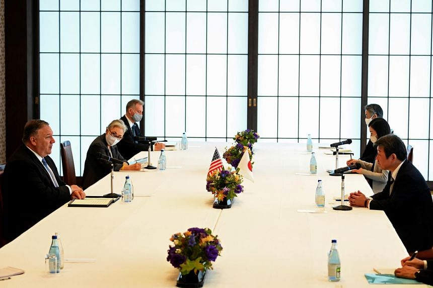 US Secretary of State Mike Pompeo (left) talks to Japanese Foreign Minister Toshimitsu Motegi in Tokyo on Oct 6, 2020.