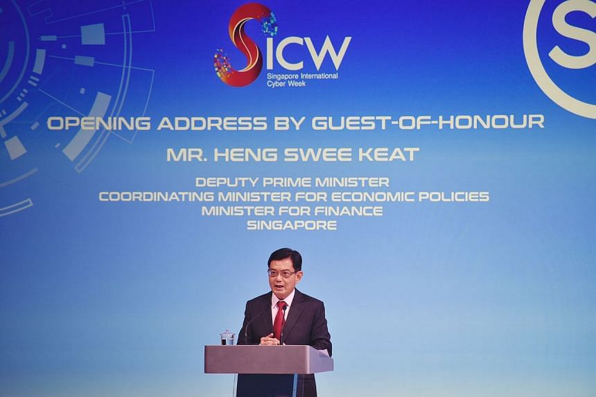 DPM Heng Swee Keat delivering the opening address at the Singapore International Cyber Week, on Oct 6, 2020.