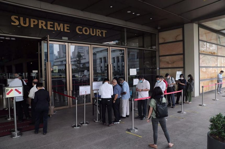 People queue to enter the Supreme Court ahead of PM Lee Hsien Loong's defamation hearing against blogger Leong Sze Hian on Oct 6, 2020.