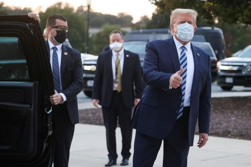 US President Donald Trump gives a thumbs up as he departs Walter Reed National Military Medical Centre in Maryland on Oct 5, 2020.