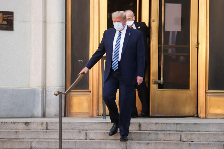 US President Donald Trump walks out of the Walter Reed National Military Medical Centre entrance in Maryland on Oct 5, 2020.