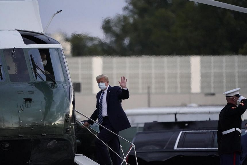 US President Donald Trump boards Marine One to return to the White House after leaving Walter Reed National Military Medical Centre in Maryland on Oct 5, 2020.
