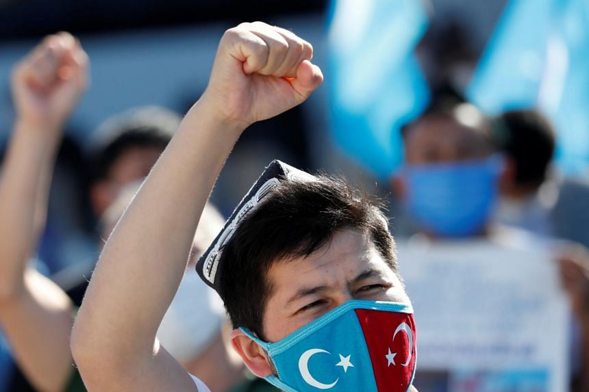 Ethnic Uighur demonstrators shout slogans during a protest against China, in Istanbul on Oct 1, 2020.