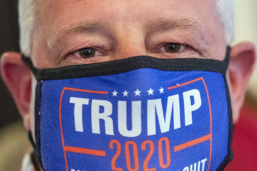 Tim Girvin wears a Trump 2020 campaign face mask during lunch in Annvile, Pennsylvania., on Oct 5, 2020.