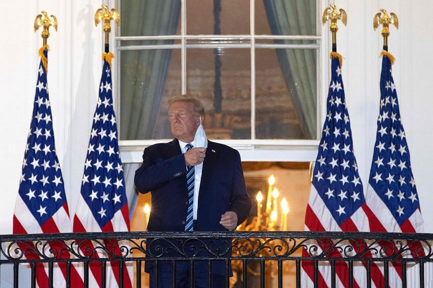 US President Donald Trump removing his mask on the White House balcony on Monday evening, alarming those who noted that a widening circle of people around him had tested positive for Covid-19 in recent days.