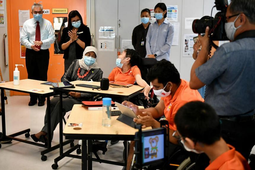 President Halimah Yacob participating in a digital artwork activity with Ms Yan Jia Yi in an IT class learning digital art on Oct 7, 2020.