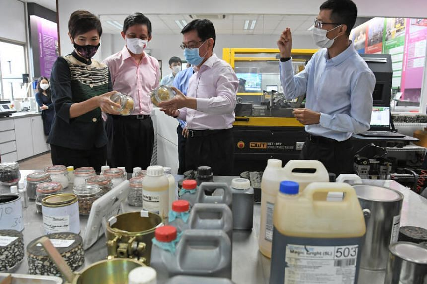 DPM Heng Swee Keat (centre), together with Manpower Minister Josephine Teo (left) and Trade and Industry Minister Chan Chun Sing (second from left) at the Samwoh R&D Centre on Oct 7, 2020.