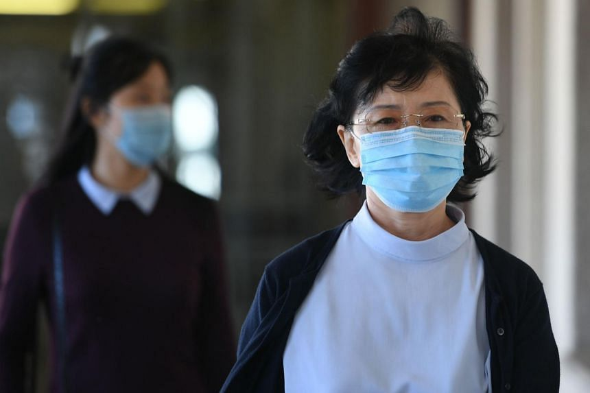 Mun Chol Myong was not in court for the ruling but his wife (pictured) and North Korean officials were present.