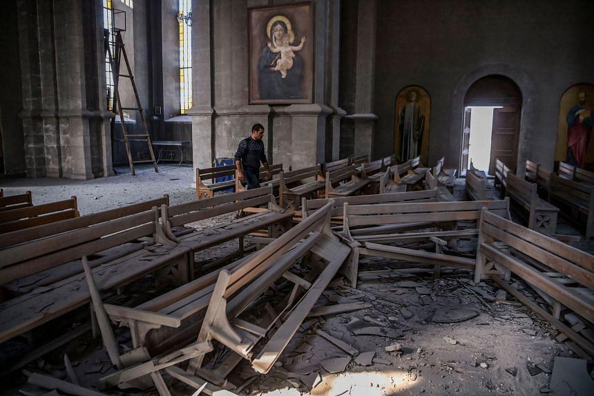 Nagorno-Karabkh: Armenia claims cathedral hit by Azerbaijan shelling