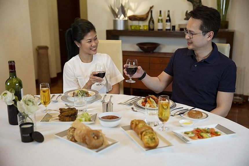 The first and business class meals (above) delivered to homes are the very ones served aboard Singapore Airlines' flights and were designed by its panel of renowned chefs.