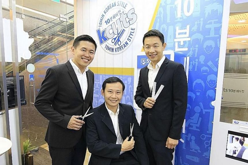 KC Group directors (from far left) Brian Ng, Bernard Ng and Samuel Pei at the kcuts outlet in Fusionopolis. The group now has eight lifestyle brands, with a total strength of 400 staff.