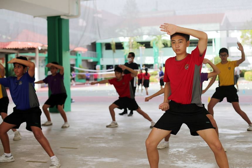 Secondary 2 students from Chua Chu Kang Secondary School during a wushu session in August. The 1m distance between students will still apply when more school and co-curricular activities resume. When they practise sports while unmasked, they should s