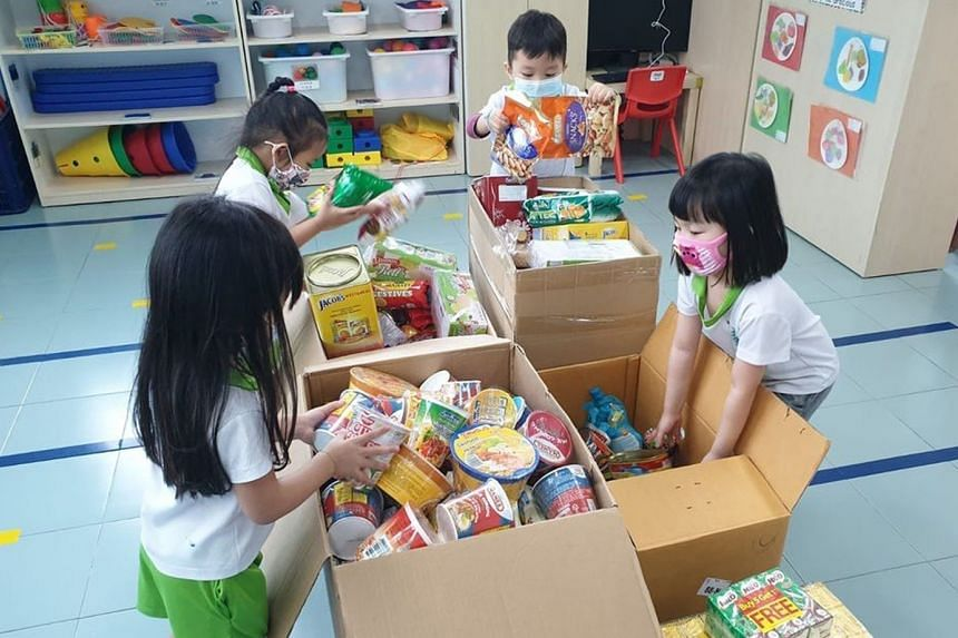 Children from Greenland Childcare @ Punggol Drive packing food supplies for migrant workers staying in dormitories. The supplies were delivered with the help of SG Accident Help Centre, a non-profit organisation.