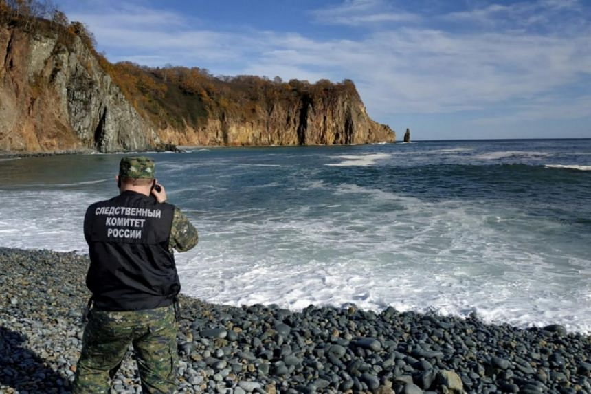 A Russian investigator working on the shore of Avacha Bay, in the Kamchatka Peninsula, Russia.