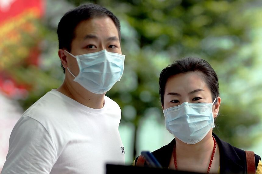 Shi Sha (right) and her husband Hu Jun each face a single charge of withholding information from a contract tracer.