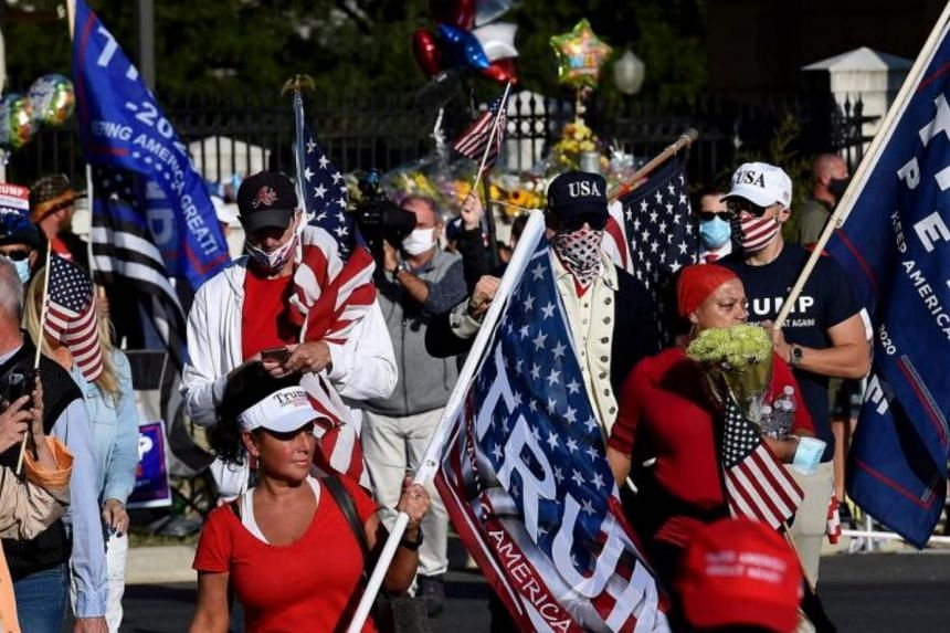 Supporters of US President Donald Trump gathering outside Walter Reed Medical Centre on Oct 5, 2020, when the president was being treated there.