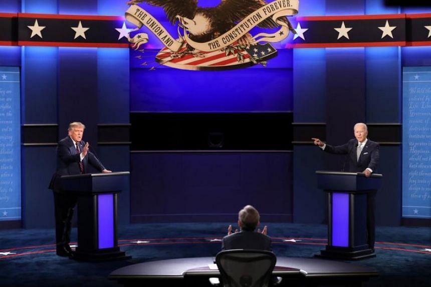 US President Donald Trump (left) and Democratic presidential candidate Joe Biden spar in Cleveland on Sept 29, 2020.