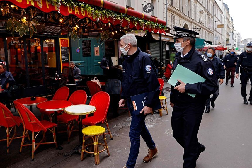Police officers patrolling a street lined with restaurants in Paris on Tuesday.