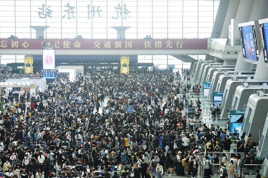 Travellers at the Hangzhou Railway Station in China's eastern Zhejiang province, on the final day of the national Golden Week holiday on Thursday. This year's travel rush has been closely watched as a barometer of the economic recovery of China, whic