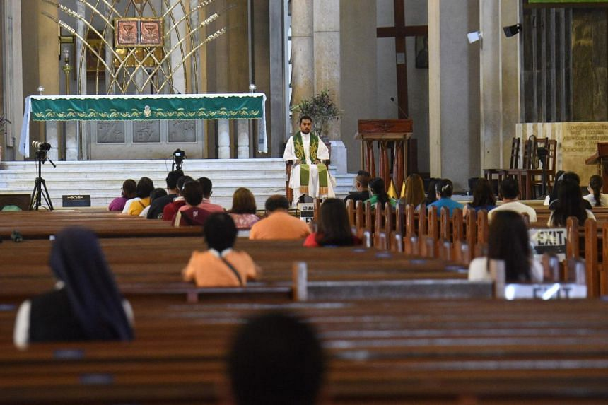 Catholics attend a mass at the usually packed Baclaran church in Paranaque, Manila on Oct 9, 2020.