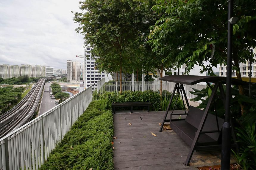 Treelodge@Punggol, Singapore's first public-housing project with eco-friendly features, incorporated greenery and a community garden in the design of the carpark roof. In Northshore Residences I (above), sensors are tapped for more efficient maintena