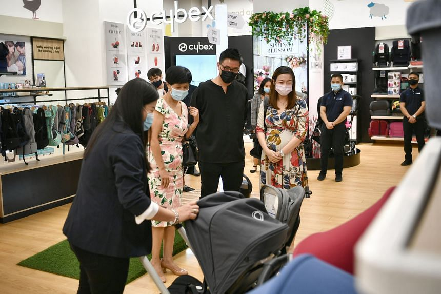 Minister in the Prime Minister's Office Indranee Rajah (second from left) being given a tour of the Mothercare Experience Store at HarbourFront Centre yesterday. It is among the businesses that have adopted the Made for Families brand mark, an initia