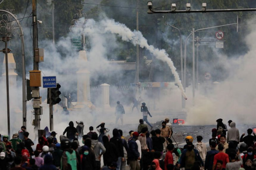Demonstrators among tear gas during a protest in Jakarta, Indonesia, on Oct 8, 2020.