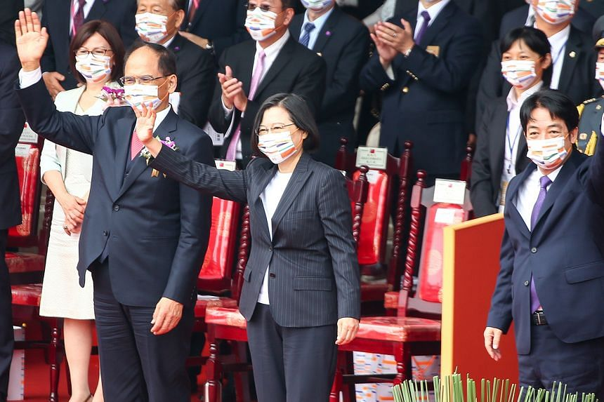 President Tsai Ing-wen flanked by Legislative Speaker Yu Shyi-kun (left) and Vice-President William Lai waving to the crowd at yesterday's celebrations. China regards self-ruling Taiwan as its territory, and has never renounced the use of force to re
