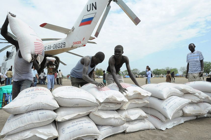 Sacks of food from the World Food Programme (WFP) being unloaded from a UN helicopter in South Sudan in 2012. A WFP official says the coronavirus shock has made clear that aid cannot keep pace with multiplying threats, adding that with the pandemic s