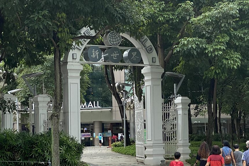 A replica of the arch of New World Amusement Park (above), one of the most frenetic venues in Singapore during its heyday from the 1920s to 1960s. One of its star acts was Rose Chan, who wrestled pythons and bent iron bars with her neck.