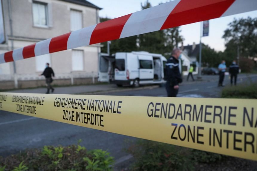 French gendarmes and firemen work near the crash site in Loches, France, on Oct 10, 2020.