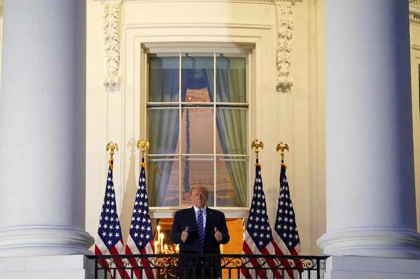 President Donald Trump on the Truman Balcony of the White House last Monday, after testing positive for Covid-19 the Thursday before and being flown to hospital. His message - that there is nothing to fear from the coronavirus - and the subsequent th