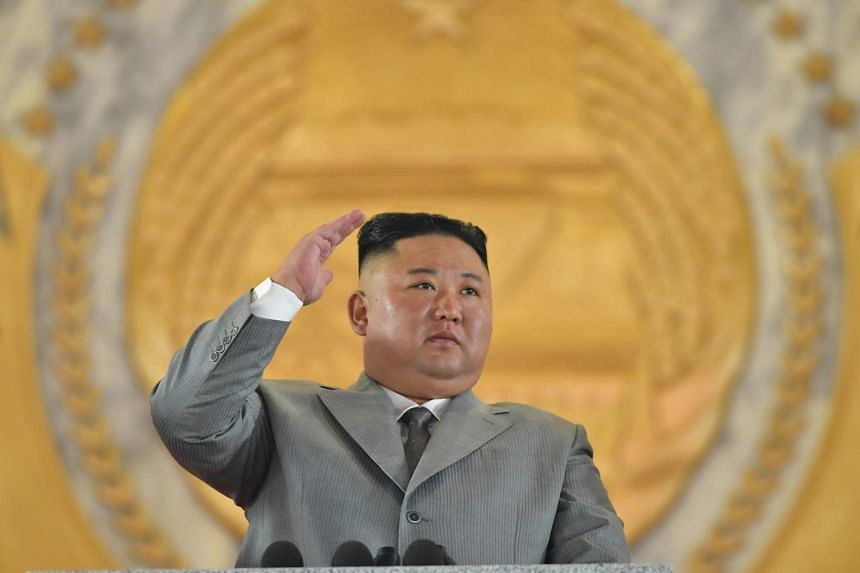 Leader Kim Jong Un watched the intercontinental ballistic missile (ICBM) roll through Kim Il Sung square in Pyongyang.