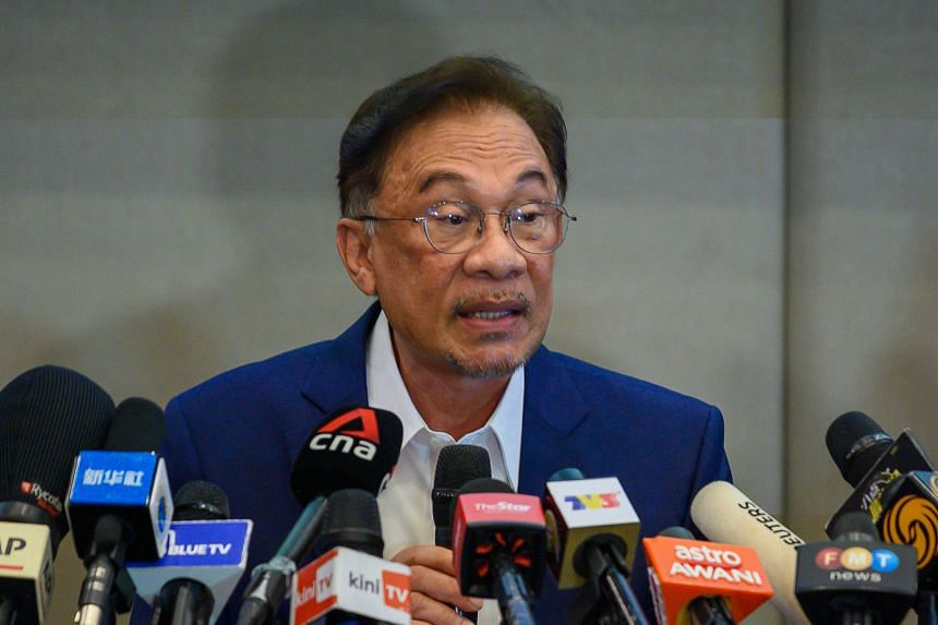Malaysian opposition leader Anwar Ibrahim speaking during a press conference at a hotel in Kuala Lumpur last month. He is scheduled to meet the Malaysian King on Tuesday to present his list of MP supporters.