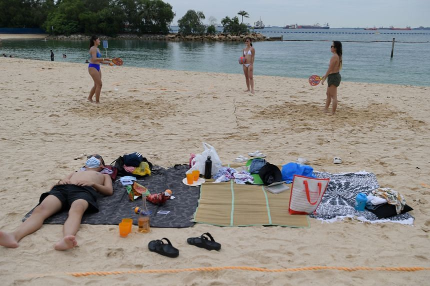 Beachgoers relaxing at Palawan beach in Sentosa yesterday. The 1.6 million visitors who came every month on average last year fell to just 8,900 in August, a 99.5 per cent decline. Changi Airport slipped from the seventh busiest to 58th for internati