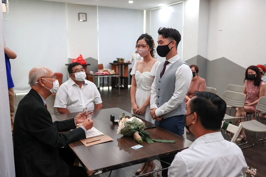 Occupational therapists Joycelyn Lim, 26, and Liew Shan Heng, 28, were among 876 couples who tied the knot on the auspicious date of Oct 10, 2020. Yesterday was the most popular wedding day in Singapore this year. Since Oct 3, up to 100 attendees for
