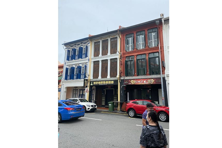 Tourist guide Chris Ng pointing out an active brothel in Keong Saik Road. The tour also stops at 17A Keong Saik Road (above), the subject of the 2017 memoir of the same name by Charmaine Leung, about her mother who grew up in a brothel in the 1970s.