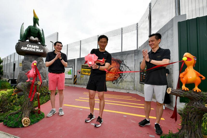 Minister for Transport Ong Ye Kung (centre) officiating the opening of the Changi Airport Connector and Jurassic Mile on Oct 11, 2020.