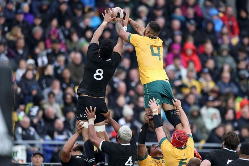 New Zealand's Ardie Savea (left) vying for the ball with Australia's Lukhan Salakaia-Loto during the Bledisloe Cup match in Wellington on Oct 11, 2020.