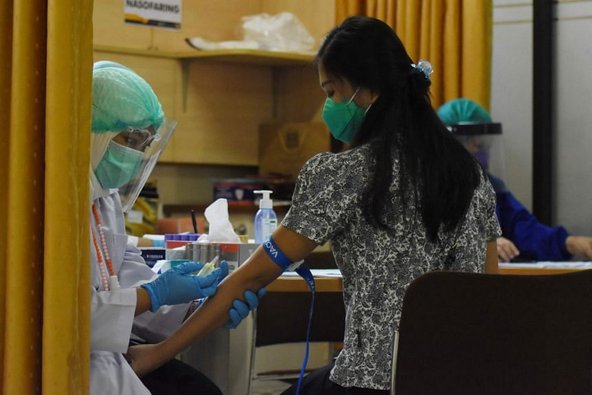 Indonesia started training health officials at community clinics to administer Covid-19 vaccines from late September.