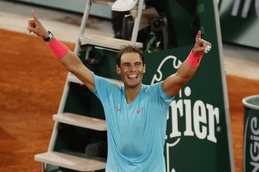 Spain's Rafael Nadal celebrates after winning the French Open final against Serbia's Novak Djokovic, on Oct 11, 2020.