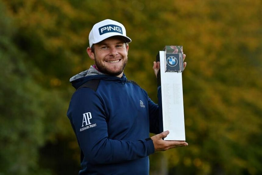 England's Tyrrell Hatton holds up the winner's trophy at the PGA Championship on Oct 11, 2020.