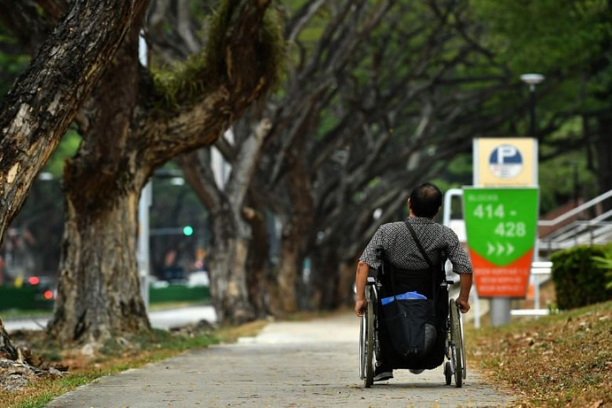 A man in wheelchair on path along Bedok North Road on Oct 2, 2019.