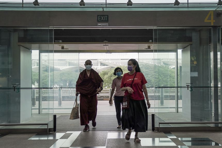 Visitors entering the departure hall of Changi Airport. Singapore is planning to start talks on air travel bubbles with countries and territories that have managed the Covid-19 pandemic well. Tourists and other travellers who come in under this propo