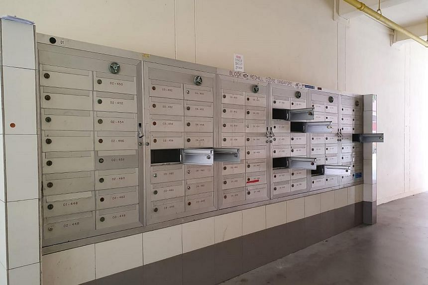 Vandalised letterboxes at one of the flats at Redhill Close. SingPost said the letterboxes in the affected blocks had been forcibly pried open.