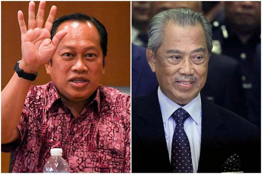 Umno secretary-general Ahmad Maslan (left) said the party is considering withdrawing support from Malaysian PM Muhyiddin Yassin's Perikatan Nasional, on Oct 13, 2020.