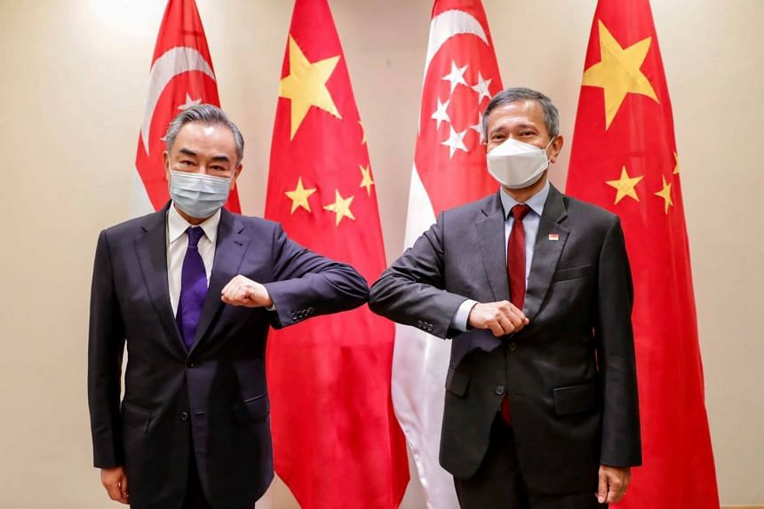 Singapore Foreign Minister Vivian Balakrishnan (right) meeting Chinese counterpart Wang Yi on Oct 13, 2020.