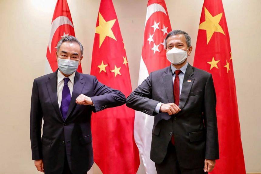 Singapore Foreign Minister Vivian Balakrishnan (right) meeting Chinese counterpart Wang Yi on Oct 13, 2020.