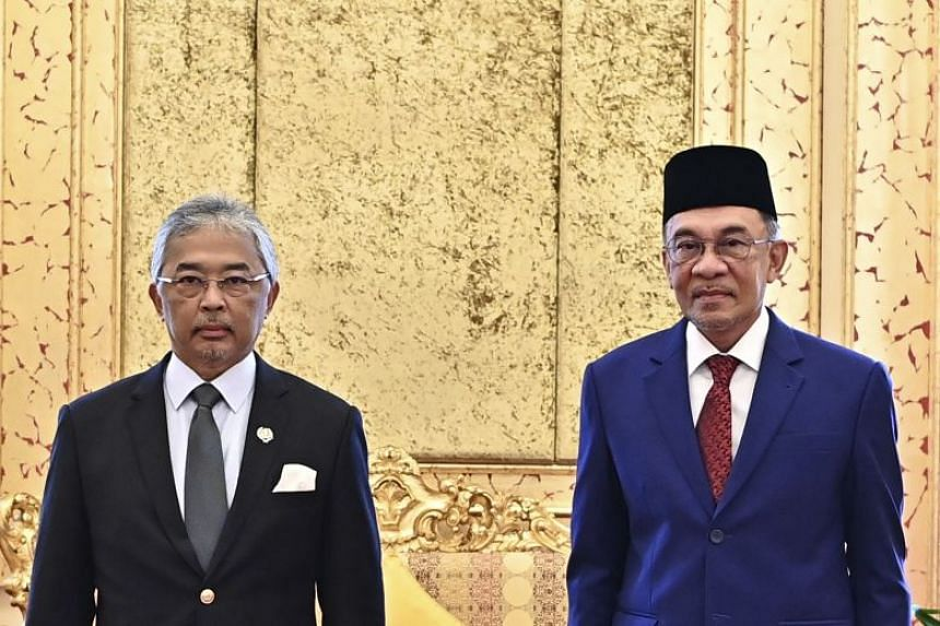 Malaysia's king, Sultan Abdullah Sultan Ahmad Shah (left), and opposition leader Anwar Ibrahim inside the Royal Palace in Kuala Lumpur on Oct 13, 2020.